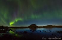 Northern lights over Tsahkaljärvi lake and Saana fjeld